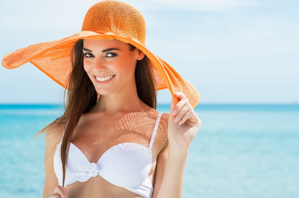 a smiling girl in bikini after using waxing services in orange park